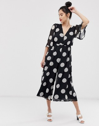 Asos DESIGN button front waisted open back jumpsuit in polka dot