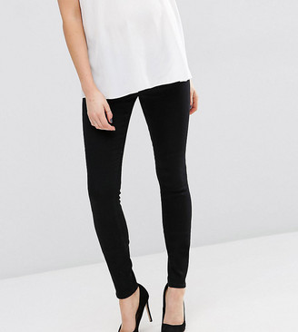 ASOS DESIGN Maternity Tall high rise ridley 'skinny' jeans in clean black with under the bump waistband