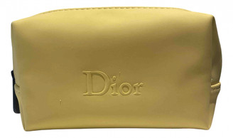 Christian Dior Yellow Synthetic Travel bags