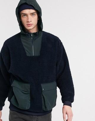 Asos DESIGN oversized half zip hoodie in teddy borg with tech pockets