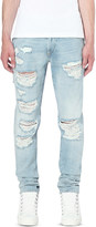 Off-White Distressed slim-fit tapered jeans