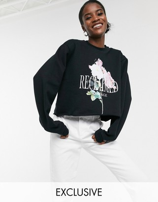 Reclaimed Vintage inspired crop sweat with logo bloom print in black