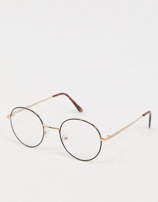 ASOS DESIGN clear lens black round glasses with gold nose bridge