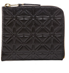 Comme des Garcons Small Star Embossed Zip Wallet in Black.