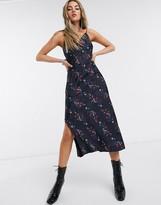 AllSaints melody spirit floral print scoop back midi slip dress in black