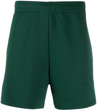 Acne Studios face patch track shorts