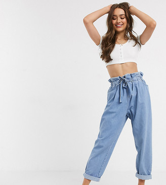 ASOS DESIGN Petite tapered leg jeans with paper bag waist in light vintage wash