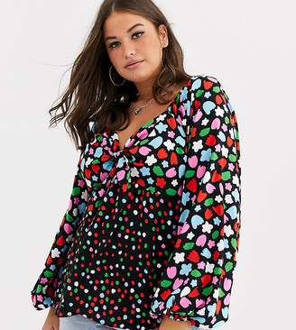 ASOS DESIGN Curve top with long volume sleeve and tie front in mix and match print