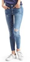Mid rise destructed true skinny ankle jeans
