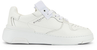 Givenchy Wing Low Top Sneakers in White | FWRD