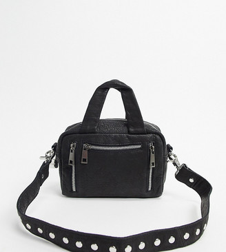Nunoo Mini Donna cross body bag with zipped compartments in black leather