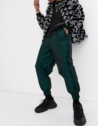 ASOS DESIGN tapered tech joggers with utility belt in green