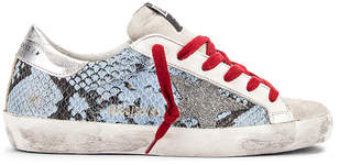Golden Goose Superstar Sneaker in Light Blue Python & Silver | FWRD
