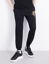 Alexander McQueen Metallic animal-embroidered cotton jogging bottoms