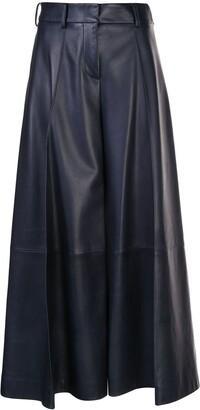 KHAITE Selma wide-leg flared trousers
