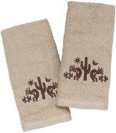 Avanti Kokopelli Festival Fingertip Towel in Ivory (Set of 2)