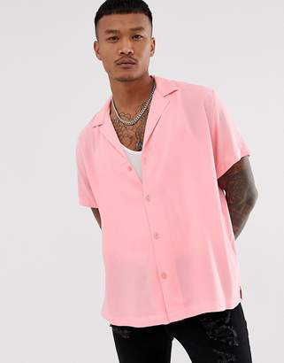 Asos Design DESIGN oversized viscose shirt with deep revere collar in bright pink
