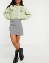 Thumbnail for your product : Monki River check print mini skirt in black