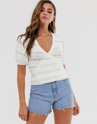 Asos DESIGN crochet wrap top with puff sleeve