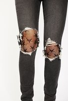 Look From London Electric Stars Fishnet Tights by at Free People