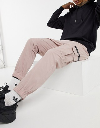 ASOS Dark Future cargo pants in pink