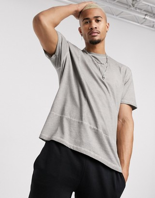 Asos DESIGN relaxed t-shirt with Unrivalled Supply logo and panelling in oil wash