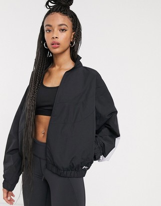 Reebok Training woven jacket in black refelective