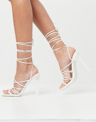 ASOS DESIGN Notion tie leg high heeled flower sandals in white