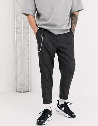 Bershka carrot fit trousers with chain in dark grey marl