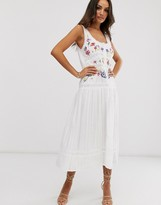 Asos DESIGN embroidered sleeveless lace insert midi dress with drop waist