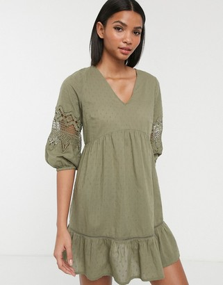 Accessorize mini beach dress with sleeve dealing in khaki