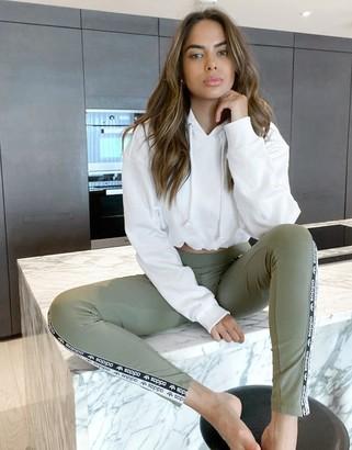 adidas RYV logo leggings in khaki