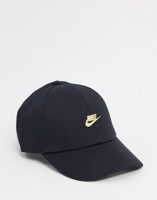 Nike metallic cap with gold logo in black