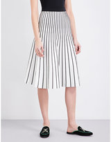 Maje Jibralto striped stretch-knit midi skirt