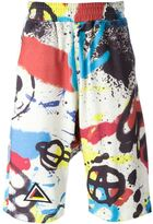 Kokon To Zai graffiti print track shorts - men - Cotton - M