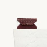 Maje Multicoloured studded leather clutch bag