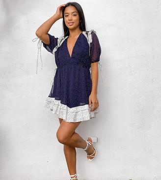 ASOS DESIGN Petite spot printed mini dress with satin trim ruffle and tie detail