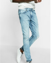 Express skinny light wash distressed stretch jeans