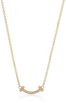 Tiffany & Co. T smile pendant in 18ct gold with diamonds, micro