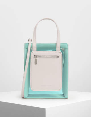 Charles & Keith Zipper Compartment Transparent Bag
