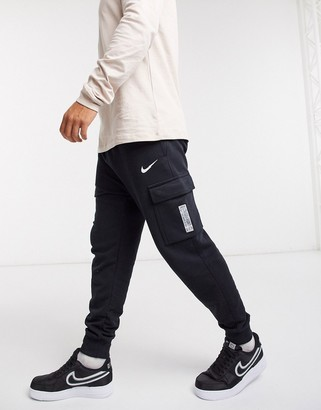 Nike Swoosh On Tour Pack cuffed cargo joggers in black