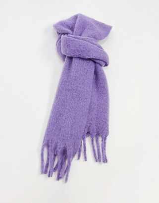 ASOS DESIGN fluffy scarf with tassels in purple marl