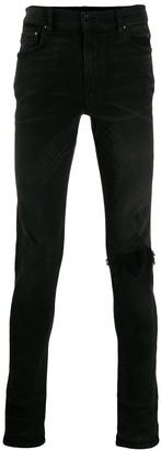 Amiri Broken skinny jeans