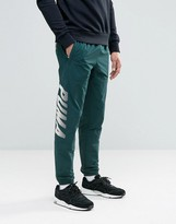 Puma Speed Font Woven Joggers In Green 57161006