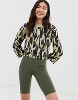 Monki camo print cropped jersey top with oversized pocket in green