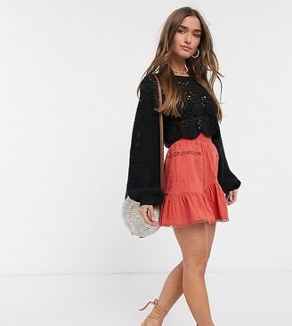 Asos DESIGN Petite textured dobby mini skirt with ruffle and lace insert in red