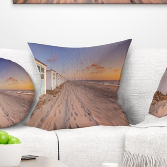 East Urban Home Landscape Row of Beach Huts at Sunset Pillow East Urban Home