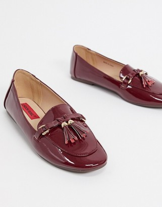 London Rebel metal trim tassel loafers in burgundy