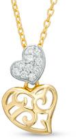 Zales 1/10 CT. T.W. Diamond Double Heart Pendant in 10K Gold