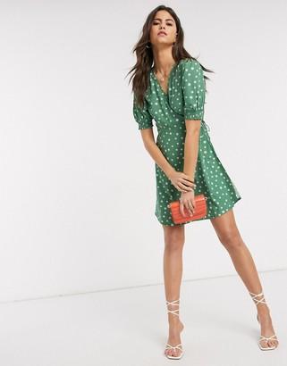 Vero Moda wrap mini dress with puff sleeve in green polka dot